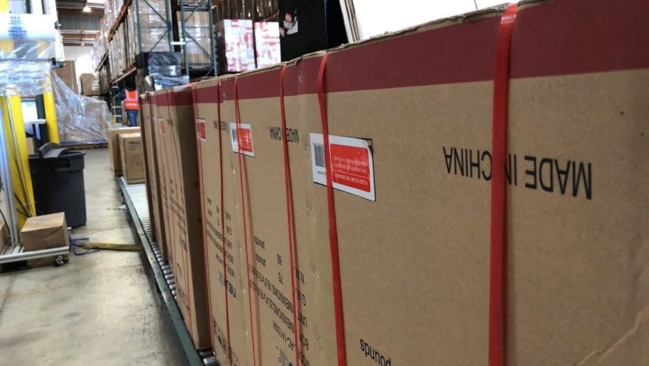 Millions of masks and coronavirus test kits are sitting in warehouses and can't reach the US because of new Chinese policies