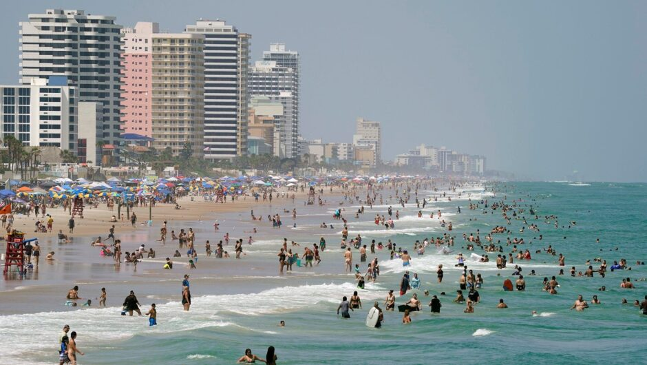 Sweltering crowds throng to beaches for Labor Day weekend, despite pandemic worries