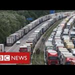 Lorry gridlock in Kent to continue for days – after France and UK agree tests for drivers – BBC News