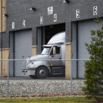 Pfizer trucks stand ready to roll out first COVID-19 vaccine